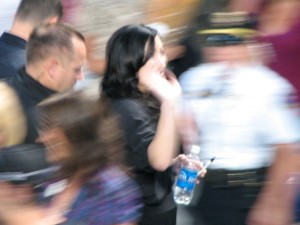 Demi waves to the crowd as she leaves
